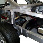 Blick in den Heckbereich eines aufgeschnittenen Audi A8 von 2010
