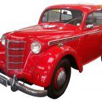 Zu sehen ist ein roter Opel Kadett von links vorne fotografiert